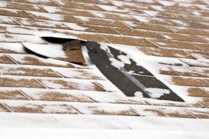 Damaged Roof in Snow